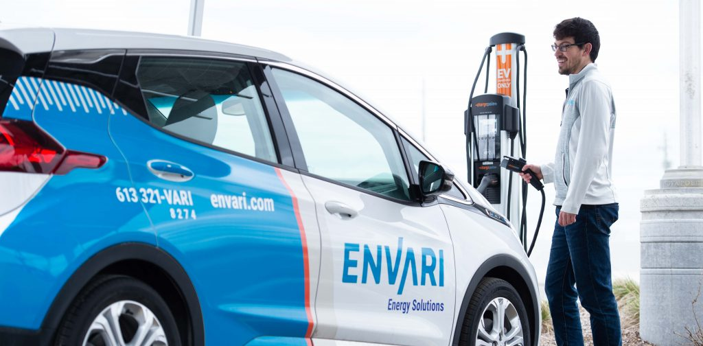 Man charging his electric vehicle.